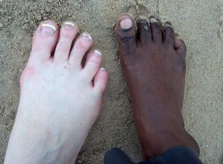 Comparing Feet at Beach
